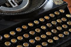 Old typewriter with letters in Russian font close-up stock photo