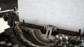 Old typewriter machine detail. Typing  on vintage typing machine stock video footage