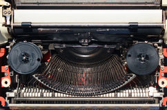 Old typewriter mechanism with black ribbon. Closeup Stock Images