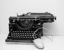 Old typewriter with mouse. Old/vintage typewriter with mouse royalty free stock photo