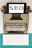 Old Typewriter, New Computer Keyboard And Tablet Pc With Text & X22;SEO& X22; Stock Photos