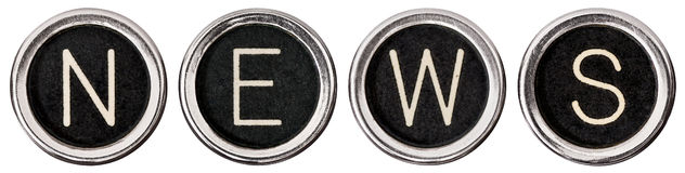Old Typewriter News. Old, scratched chrome typewriter keys with black centers and white letters spelling out the word, NEWS.  Isolated on white with clipping Stock Image