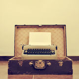 Old typewriter in an old suitcase, with a retro effect Royalty Free Stock Photo