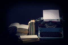 Old typewriter with opened books retro colors on the desk Stock Photography