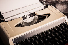 Old typewriter with paper Stock Photo