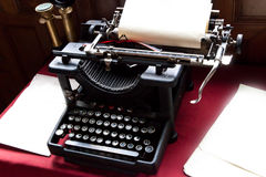 Old typewriter and paper on writers desk Royalty Free Stock Image
