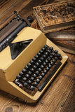Old typewriter, a pile of books and a lot of creativity Stock Image