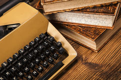Old typewriter, a pile of books and a lot of creativity Stock Photography