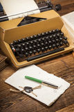 Old typewriter, a pile of books and a lot of creativity Royalty Free Stock Photo