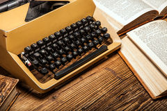 Old typewriter, a pile of books and a lot of creativity Stock Photo