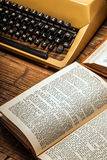 Old typewriter, a pile of books and a lot of creativity Royalty Free Stock Photos