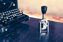 Old typewriter and rubber stamp Royalty Free Stock Photography