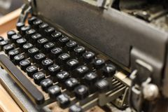 Old typewriter with Russian and English letters. Close-up stock images