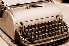Old typewriter. Old rusty typewriter close-up. Sepia Stock Photography