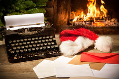 Old typewriter and Santa Claus hat on desk Stock Images