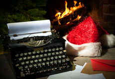 Old typewriter and Santa Claus hat on desk Stock Photo