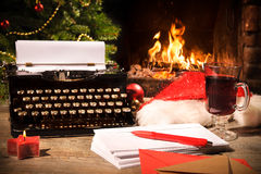 Old typewriter and Santa Claus hat on desk Stock Photos