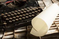 Old typewriter. On old typewriter and sheet on cartboard stock photos