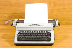 Old typewriter and  sheet of paper Royalty Free Stock Image