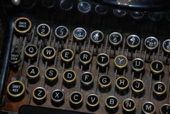 Old typewriter showing letter and number keys stock photography