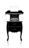 Old typewriter on a small table Royalty Free Stock Photos