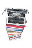 Old typewriter on the stack of books Stock Image