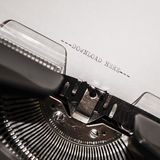 Old typewriter with text download here Stock Photo