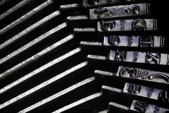 Old typewriter type bars stock image