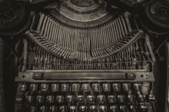 Old typewriter. View of an antique manual old typewriter on sepia stock image