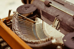 Old Typewriter In Vintage Tone. The old English typewriter is old object in warm vintage tone Royalty Free Stock Photo