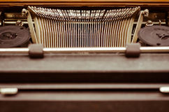 Old Typewriter In Vintage Tone. The old English typewriter is old object in warm vintage tone Stock Images
