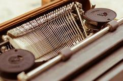 Old Typewriter In Vintage Tone. The old English typewriter is old object in warm vintage tone Stock Photos