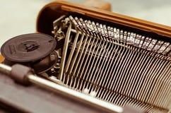 Old Typewriter In Vintage Tone. The old English typewriter is old object in warm vintage tone Stock Image