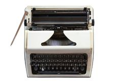Old typewriter on white isolated background. retro style and Antiques stock photography