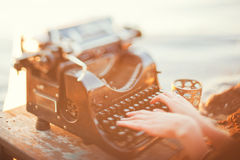 Old typewriter. And womens hands Royalty Free Stock Images