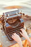 Old typewriter. And womens hands Stock Photography