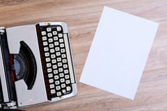 Old typewriter on wooden ground Royalty Free Stock Photos