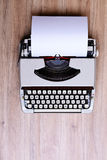 Old typewriter on wooden ground Royalty Free Stock Photography