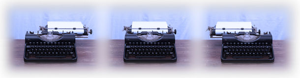 Old typewriter on wooden table Royalty Free Stock Images