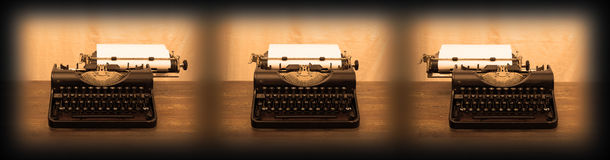 Old typewriter on wooden table Stock Photo