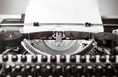 Old typewriter on wooden table. Vintage style tinted photo. Stock Image