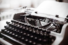 Old typewriter on wooden table. Vintage style tinted photo. Stock Photography