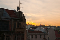 Old typical buildings in Lisboa, Portugal, at sunset Stock Images