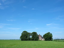 Old typical farm under blue sky in the coutryside just outside c Royalty Free Stock Photos