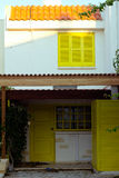 Old typical Mediterranean house with yellow wooden shutters Stock Photo