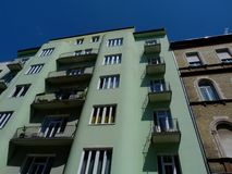 Old typical mid-rise condominium building in Budapest in low angle view with small balconies. Old typical mid-rise condominium building in Budapest in low angle stock photo