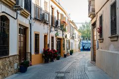Old typical narrow street in the jewish quarter of Cordoba with stock image