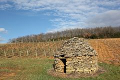 Old and typical stone hut in the vineyards of Beaujolais Royalty Free Stock Images