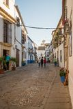 Old typical street in the jewry of Cordoba. Cordoba, Spain - April 10, 2017: Old typical street in the Alcazar Viejo quarter of Cordoba with white walls Stock Photography