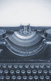 Old typing machine and blank sheet of paper for your text, cyano Stock Images